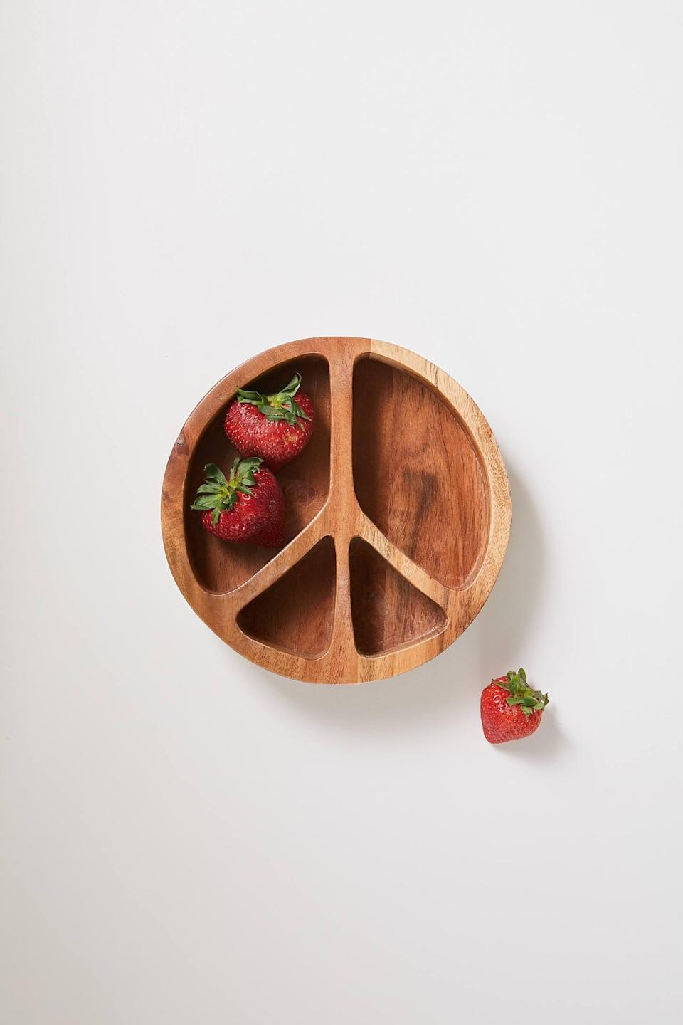 <p>Allow them to munch on their favorite foods in peace with the <span>Peace Sign Snack Bowl</span> ($18).</p>