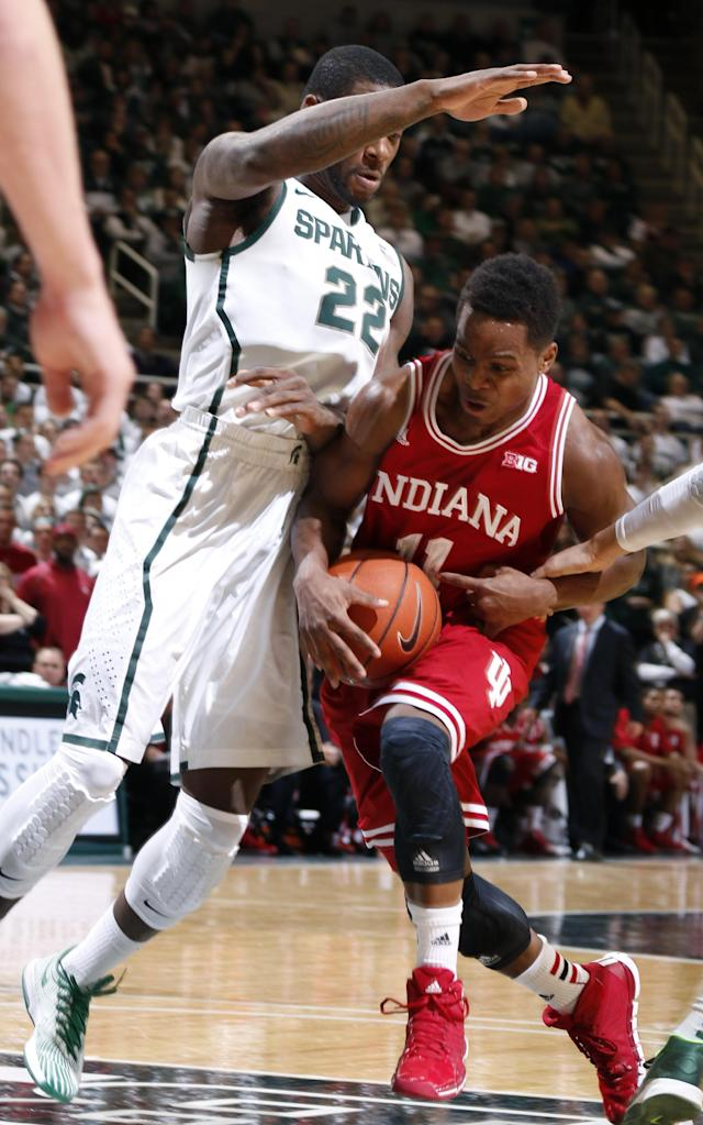 Indiana's Yogi Ferrell, right, drives against Michigan State's Branden Dawson (22) during the first half of an NCAA college basketball game, Tuesday, Jan. 21, 2014, in East Lansing, Mich. (AP Photo/Al Goldis)