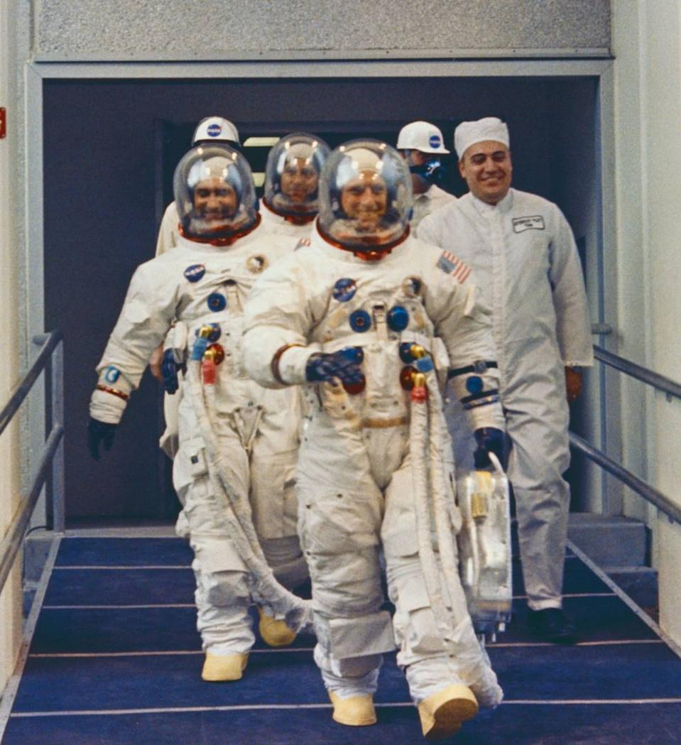 Apollo 12 astronauts Pete Conrad (front) Richard Gordon (left) and Alan Bean (center top in background) walk out to the Astovan for the trip to the launch pad at NASA's Kennedy Space Center in Florida ahead of their Nov. 14, 1969 launch.