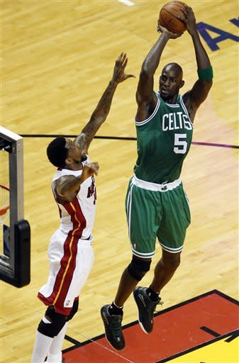 Boston Celtics' Kevin Garnett (5) shoots over Miami Heat's Udonis Haslem during the first half of Game 7 of the NBA basketball playoffs Eastern Conference finals, Saturday, June 9, 2012, in Miami. (AP Photo/Wilfredo Lee)