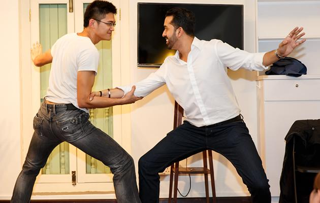 "Kamil Haque battles out with a student in a game called ""What is you in tension?"" (Marc Chang Photo)"