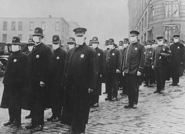 Seattle policemen wearing protective gauze face masks during the influenza pandemic of 1918. (Time Life Pictures/National Archives/The Life Picture Collection via Getty Images)