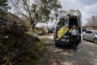 Paramedic Laura Russell of Acadian Ambulance service gets out of an ambulance on a call in a neighborhood damaged by Hurricane Ida, Friday, Sept. 3, 2021, in Houma, La. (AP Photo/John Locher)