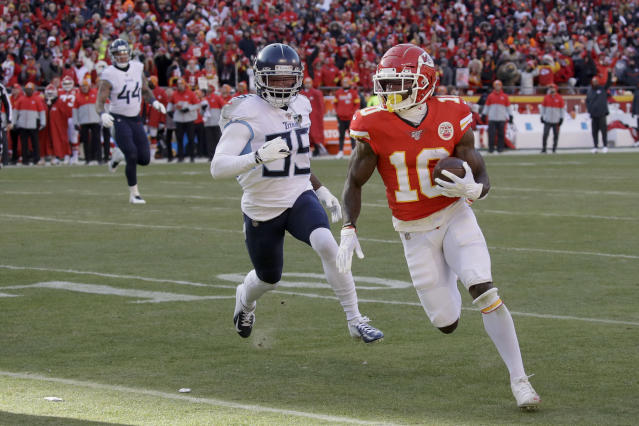 Kansas City Chiefs' Tyreek Hill runs for a touchdown during the first half of the NFL AFC Championship football game against the Tennessee Titans Sunday, Jan. 19, 2020, in Kansas City, MO. (AP Photo/Charlie Riedel)