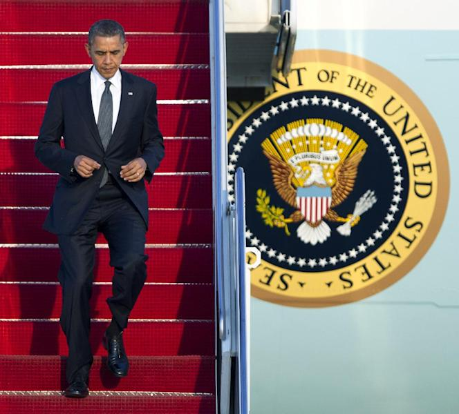 President Barack Obama jogs down the ramp from Air Force One as he arrives Andrews Air Force Base, Md., Thursday, March 22, 2012. (AP Photo/Manuel Balce Ceneta)