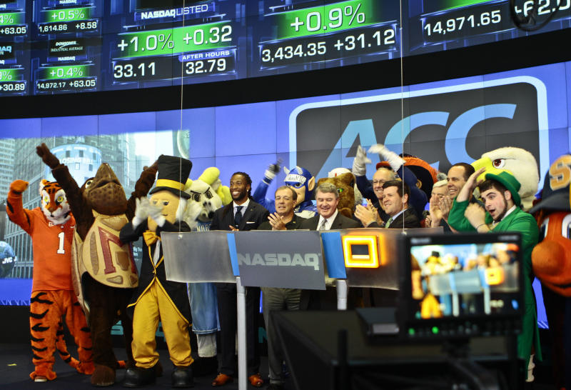 Atlantic Coast Conference mascots join ACC and NASDAQ officials for the ringing of the closing bell on Monday, July 1, 2013 in New York. The Atlantic Coast Conference officials and coaches visited the NASDAQ Market Site in Times Square to officially announce the addition of its three new members in Notre Dame, Pitt and Syracuse. (AP Photo/Bethan McKernan)