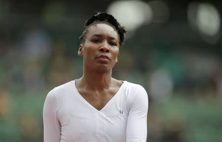 Venus Williams of the U.S. looks on during a women's singles match against Anna Schmiedlova of Slovakia at the French Open tennis tournament at the Roland Garros stadium in Paris May 28, 2014. REUTERS/Stephane Mahe (FRANCE - Tags: SPORT TENNIS)