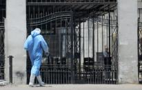 A member of medical team wearing protective equipment enters the Institute of Research for Tropical Medicine amid concerns about the spread of the coronavirus disease (COVID-19), in Cairo
