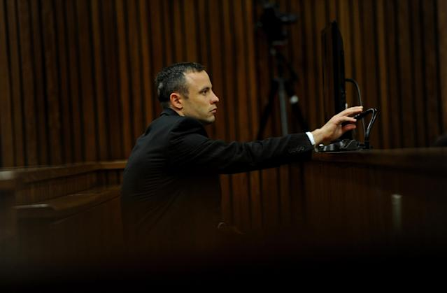 BY COURT ORDER, THESE IMAGES ARE FREE TO USE. PRETORIA, SOUTH AFRICA - APRIL 16: (SOUTH AFRICA OUT): Oscar Pistorius listens to evidence in the Pretoria High Court on April 16, 2014, in Pretoria, South Africa. Oscar Pistorius stands accused of the murder of his girlfriend, Reeva Steenkamp, on February 14, 2013. This is Pistorius' official trial, the result of which will determine the paralympian athlete's fate. (Photo by Werner Beukes/SAPA/Gallo Images/Getty Images)