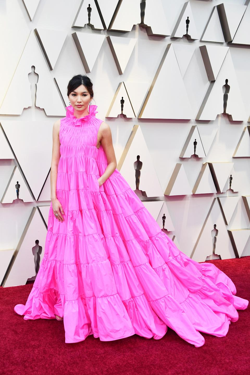"""<h2>Gemma Chan, 2019</h2><br>Hot pink came out running at the 91st Annual Academy Awards. But if you ask us, Gemma Chan won the marathon in this neon, tiered Versace dress.<br><br><em>Gemma Chan in Versace. </em><span class=""""copyright"""">Photo by Frazer Harrison/Getty Images.</span>"""