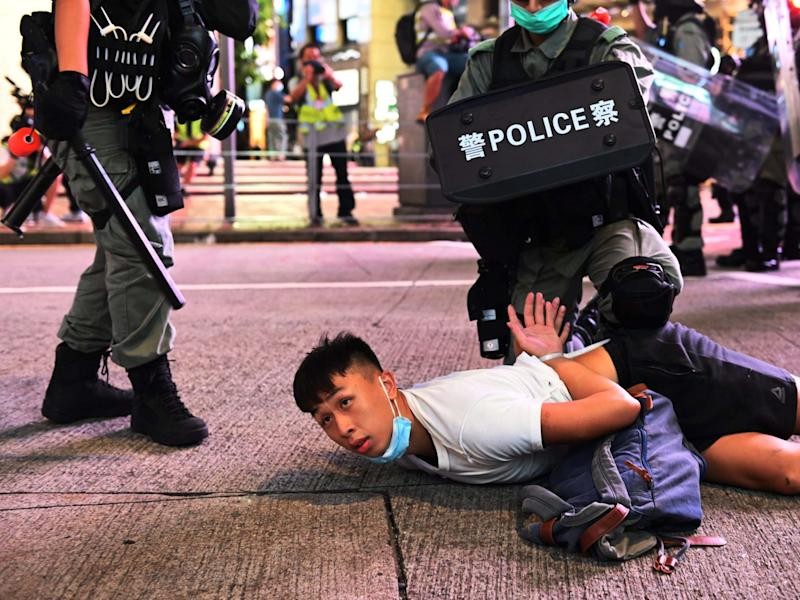 Police officers detain protesters during a rally against a new national security law on the 23rd anniversary of the establishment of the Hong Kong Special Administrative Region in Hong Kong, China, 1 July 2020: Miguel Candela/EPA