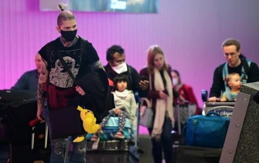 Travellers arrive at Los Angeles International Airport, one day before a US travel ban hits 26 European countries