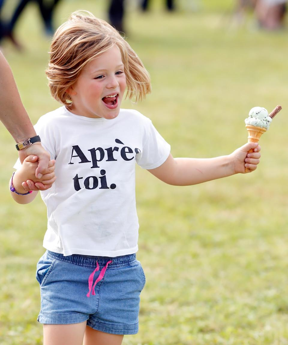 <p>Mia Tindall eats an ice cream at the Whatley Manor Gatcombe International Horse Trials at Gatcombe Park in 2019. (Max Mumby/Indigo/Getty Images)</p>