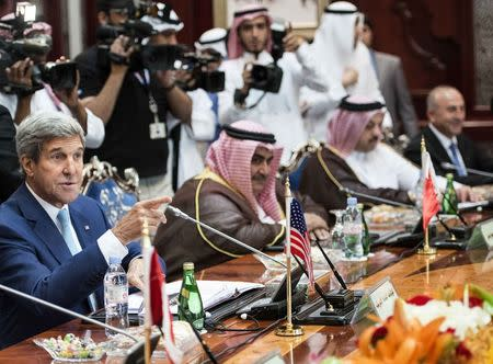 U.S. Secretary of State John Kerry talks with other attendees before the start of a Gulf Cooperation Council and Regional Partners meeting in Jeddah September 11, 2014. REUTERS/Brendan Smialowski/Pool