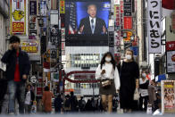 A screen at the Shinjuku shopping district in Tokyo displays a live broadcast of U.S. President-elect Joe Biden speaking Sunday, Nov. 8, 2020. (AP Photo/Kiichiro Sato)
