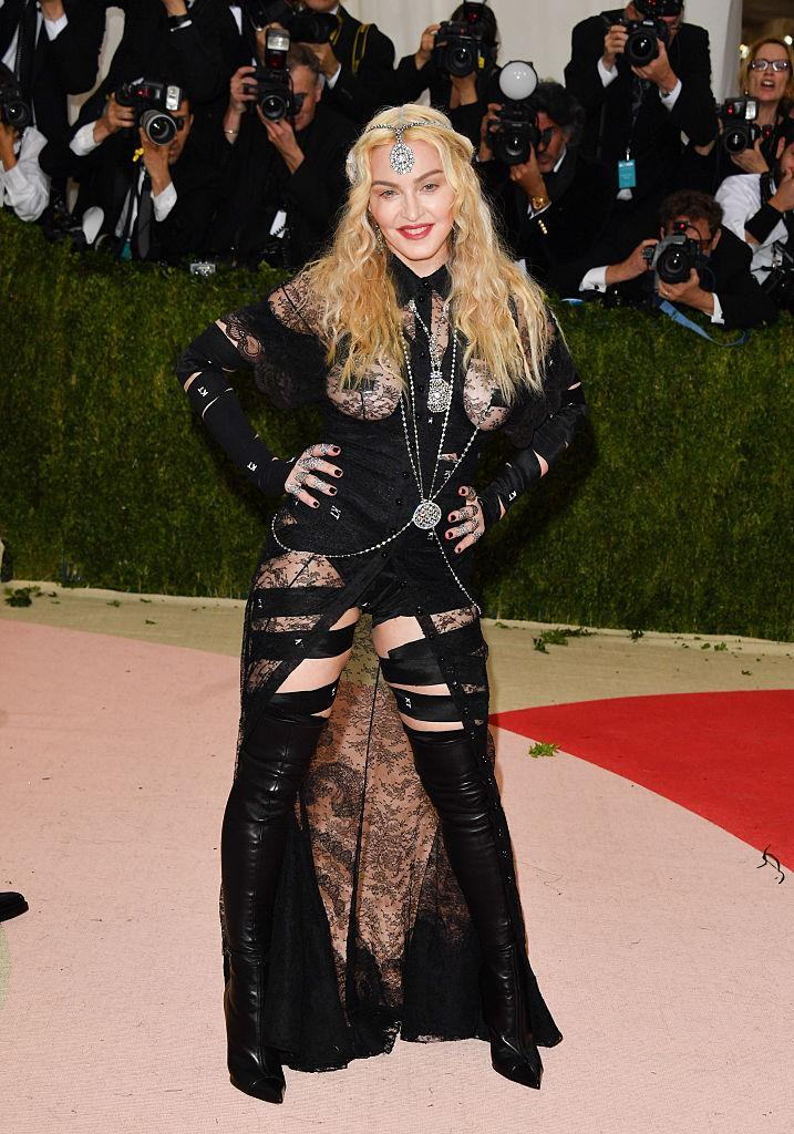 <p>Madonna pulled out all the stops… like <em>every, single, stop. </em>Lace: stop. Leather: please stop. Bandages: just stop. Nipple tape: make it stop! <i>(Photo via Getty Images)</i> </p>