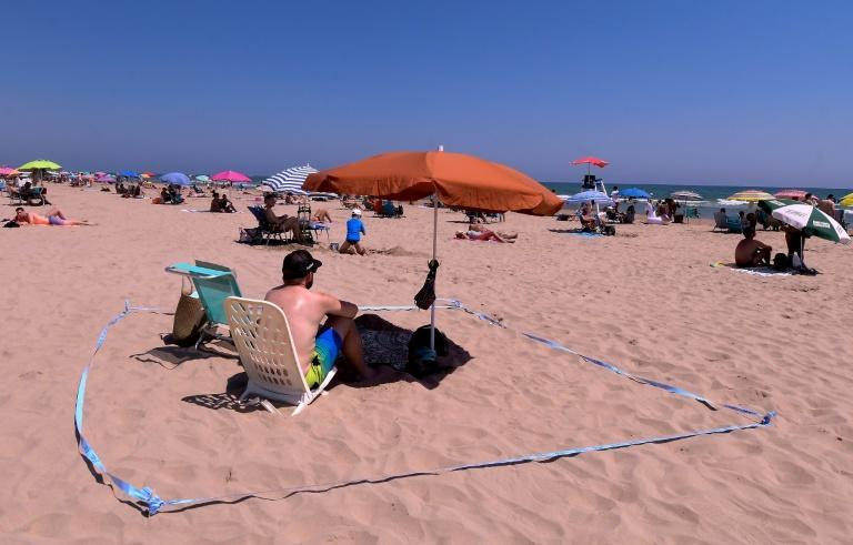 You won't need to wear a mask while sunbathing on Spanish beaches, but you'll need to keep your distance from others