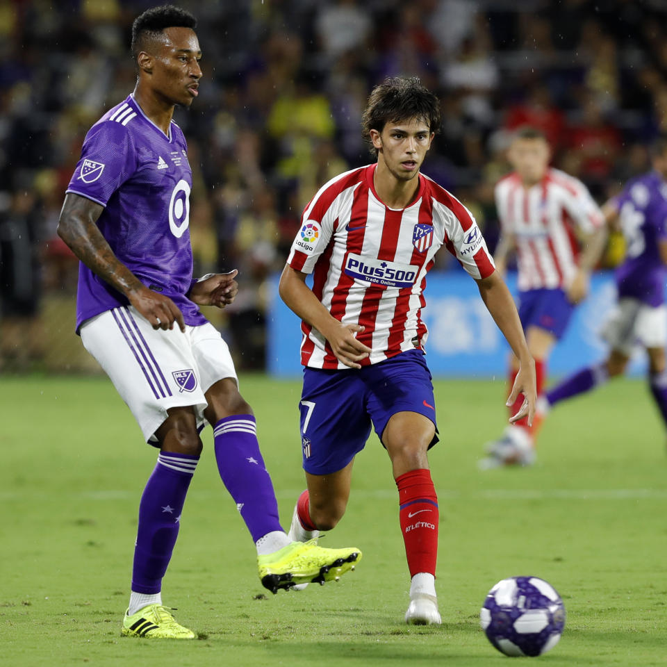 ORLANDO, FL - JULY 31: Mark-Anthony Kaye of MLS All-Stars and Joao Felix of Atletico de Madrid battle for the ball during the 2019 MLS All-Star Game between MLS All Stars and Atletico de Madrid at Exploria Stadium on July 31, 2019 in Orlando, Florida.(Photo by TF-Images/Getty Images)
