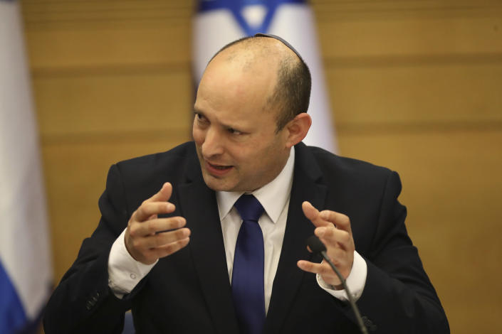 Israel's new prime minister Naftali Bennett holds a first cabinet meeting in Jerusalem Sunday, June 13, 2021. Israel's parliament has voted in favor of a new coalition government, formally ending Prime Minister Benjamin Netanyahu's historic 12-year rule. Naftali Bennett, a former ally of Netanyahu became the new prime minister (AP Photo/Ariel Schalit)