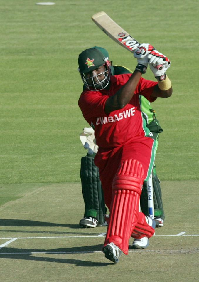 Zimbabwe's batsman Hamilton Masakadza plays a shot during the second and final Twenty20 international between Zimbabwe and Pakistan at the Harare Sports Club on August 24, 2013.   AFP PHOTO / JEKESAI NJIKIZANA        (Photo credit should read JEKESAI NJIKIZANA/AFP/Getty Images)