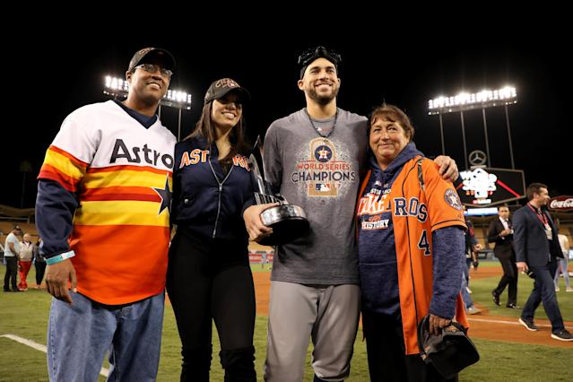 <p>George Springer #4 of the Houston Astros holds the 2017 Willie Mays World Series Most Valuable Player (MVP) Award as he poses with family members after defeating the Los Angeles Dodgers 5-1 in game seven to win the 2017 World Series at Dodger Stadium on November 1, 2017 in Los Angeles, California. (Photo by Christian Petersen/Getty Images) </p>