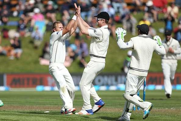 DUNEDIN, NEW ZEALAND - MARCH 08: Neil Wagner (L) and Jimmy Neesham celebrate the dismissal of Hashim Amla of South Africa during day one of the First Test match between New Zealand and South Africa at University Oval on March 8, 2017 in Dunedin, New Zealand. (Photo by Dianne Manson/Getty Images)