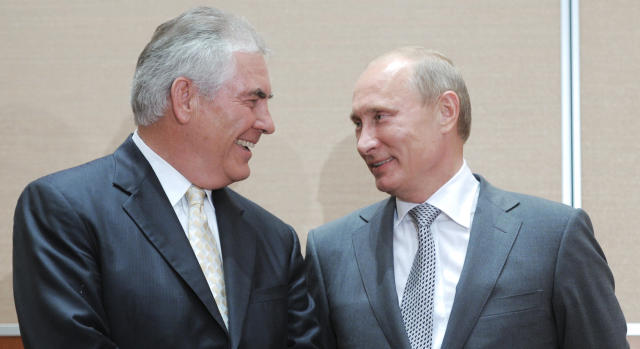 As CEO of Exxon Mobil, Rex Tillerson met Russian President Vladimir Putin in 2011. His business ties to Russia raised concerns over his appointment.