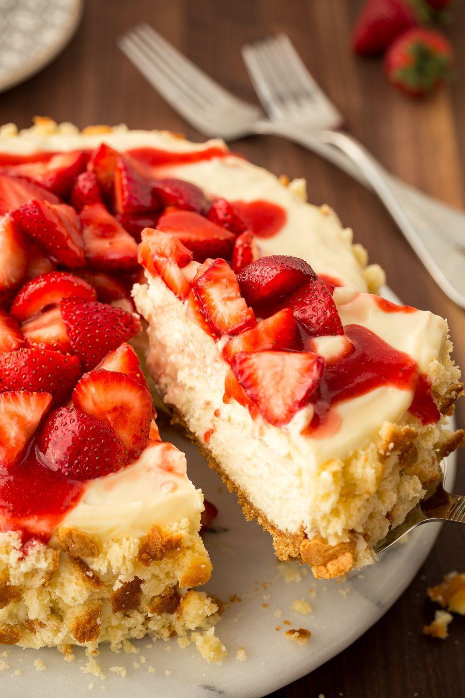 """<p>A cheesecake version makes the dessert even creamier.</p><p>Get the recipe from <a href=""""https://www.delish.com/cooking/recipe-ideas/recipes/a47084/strawberry-shortcake-cheesecake-dessert-recipe/"""" rel=""""nofollow noopener"""" target=""""_blank"""" data-ylk=""""slk:Delish"""" class=""""link rapid-noclick-resp"""">Delish</a>. </p>"""