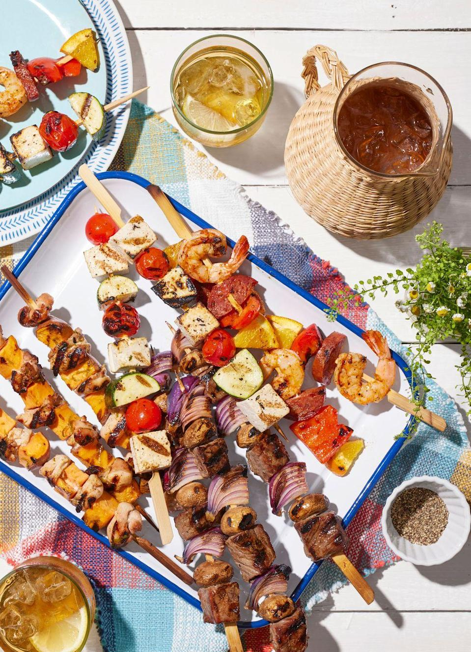 """<p>There's a reason kebabs are such a hit. Who doesn't love bite-sized bits of perfectly seasoned, well-grilled food on a stick? Here, we've got four different pairings of kebabs that will grill well together, from steak and onion to tofu and cherry tomato.</p><p><strong><a href=""""https://www.countryliving.com/food-drinks/a36743130/shrimp-pepper-and-chorizo-kebabs-recipe/"""" rel=""""nofollow noopener"""" target=""""_blank"""" data-ylk=""""slk:Get the recipe for Shrimp, Pepper, and Chorizo Kebabs"""" class=""""link rapid-noclick-resp"""">Get the recipe for Shrimp, Pepper, and Chorizo Kebabs</a>.<br></strong></p><p><strong><a href=""""https://www.countryliving.com/food-drinks/a36743231/tofu-tomato-and-zucchini-kebabs-recipe/"""" rel=""""nofollow noopener"""" target=""""_blank"""" data-ylk=""""slk:Get the recipe for Tofu, Tomato, and Zucchini Kebabs"""" class=""""link rapid-noclick-resp"""">Get the recipe for Tofu, Tomato, and Zucchini Kebabs</a>.<br></strong></p><p><strong><a href=""""https://www.countryliving.com/food-drinks/a36743354/teriyaki-beef-and-mushroom-kebabs-recipe/"""" rel=""""nofollow noopener"""" target=""""_blank"""" data-ylk=""""slk:Get the recipe for Teriyaki Beef-and-Mushroom Kebabs"""" class=""""link rapid-noclick-resp"""">Get the recipe for Teriyaki Beef-and-Mushroom Kebabs</a>.</strong></p><p><strong><a href=""""https://www.countryliving.com/food-drinks/a36742999/chicken-and-sweet-potato-kebabs-recipe/"""" rel=""""nofollow noopener"""" target=""""_blank"""" data-ylk=""""slk:Get the recipe for Chicken and Sweet Potato Kebabs"""" class=""""link rapid-noclick-resp"""">Get the recipe for Chicken and Sweet Potato Kebabs</a>.</strong><br></p>"""