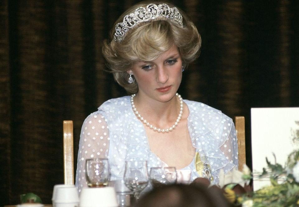 <p>At a banquet in New Zealand, the princess sported the Spencer tiara along with a pearl necklace and matching earrings. Diana completed the look with a powder blue dress by the Emmanuels, who also designed her wedding dress. <br></p>