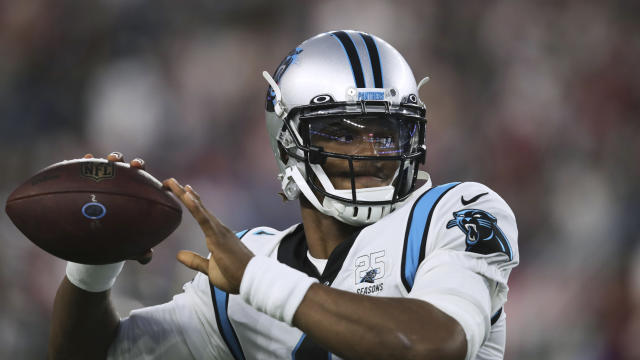 Could quarterback Cam Newton land in Chicago? (AP Photo/Charles Krupa)