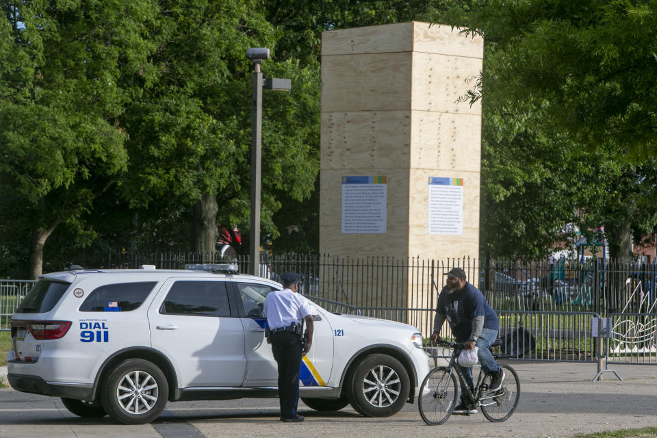 FILE - This June 17, 2020 file photo shows Philadelphia police at Marconi Plaza near the Columbus statue in Philadelphia. Monday, Oct. 11, 2021 federal holiday dedicated to Christopher Columbus continues to divide those who view the explorer as a representative of Italian Americans' history and those horrified by an annual tribute that ignores the native people whose lives and culture were forever changed by colonialism. (Alejandro A. Alvarez/The Philadelphia Inquirer via AP, File)