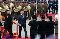 South Korea's Moon (R) has been instrumental in brokering the diplomatic thaw that saw a historic summit between Kim Jong Un (L) and US President Donald Trump in Singapore in June, where Kim backed denuclearisation of the Korean peninsula