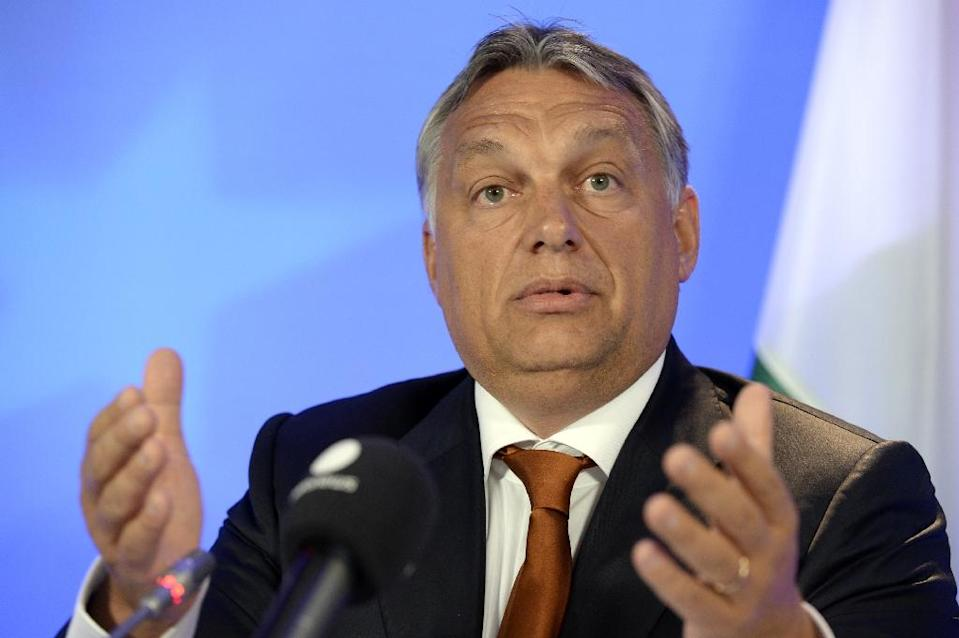 "Hungary's Prime Minister Viktor Orban says his country has a ""democratic right"" to a different approach on the migrant crisis (AFP Photo/Thierry Charlier)"