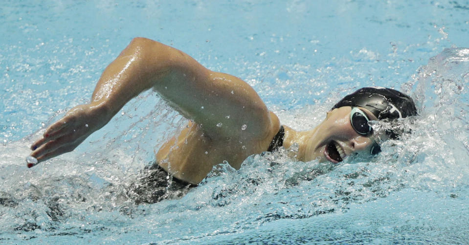 File-This July 27, 2019, file photo shows United States' Katie Ledecky swimming in the women's 800m freestyle final at the World Swimming Championships in Gwangju, South Korea. Like everyone else, Ledecky was forced to shelve her plans when the coronavirus pandemic took hold. Instead of looking far into the future, the five-time Olympic champion swimmer switched to a more immediate mindset. Forget that the four-year cycle leading to the 2024 Paris Olympics is already underway. Ledecky is still working toward making a big splash at this summer's delayed Tokyo Games (AP Photo/Mark Schiefelbein, File)