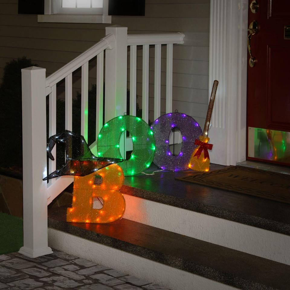 <p>Add lighting with this <span>Orange and Purple LED Lighted Boo Sign</span> ($61, originally $91). You can either set it on your front porch or hang it.</p>