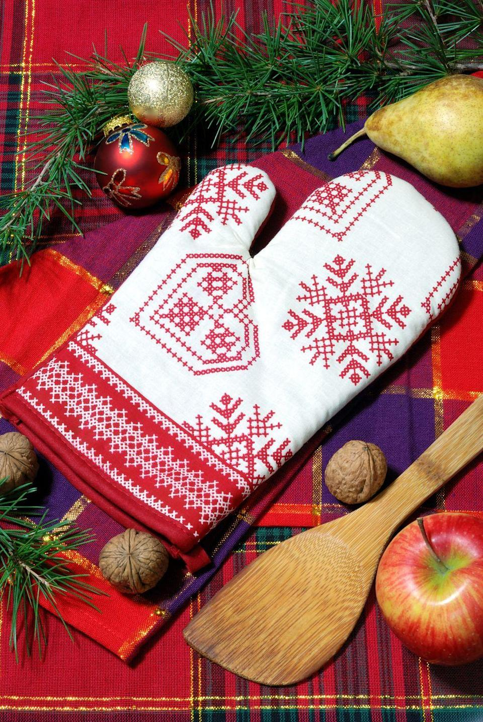 """<p>Opening <a href=""""https://www.goodhousekeeping.com/holiday-gift-ideas/"""" rel=""""nofollow noopener"""" target=""""_blank"""" data-ylk=""""slk:Christmas gifts"""" class=""""link rapid-noclick-resp"""">Christmas gifts</a> while wearing oven mitts is just as hard (and hilarious) as you think. As an added perk, giving unwrapping an element of difficulty will make everyone slow down and savor the moment when opening presents on Christmas morning — not to mention result in some really fun photos.</p><p><em><a href=""""http://rko-ideas-galore.blogspot.com/2010/12/merry-christmitts-game.html"""" rel=""""nofollow noopener"""" target=""""_blank"""" data-ylk=""""slk:Get the tutorial from Karen's Ideas Galore »"""" class=""""link rapid-noclick-resp"""">Get the tutorial from Karen's Ideas Galore »</a></em></p>"""