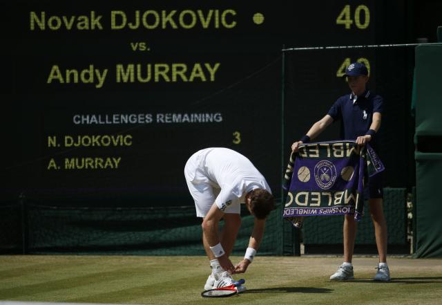 Great Britain's Andy Murray ties his shoe laces in his Men's Final against Serbia's Novak Djokovic during day thirteen of the Wimbledon Championships at The All England Lawn Tennis and Croquet Club, Wimbledon.