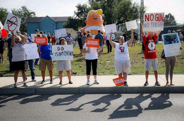 PHOTO: People gather to protest the arrival of President Donald Trump Aug. 7, 2019, outside Miami Valley Hospital after a mass shooting, in Dayton, Ohio. (John Minchillo/AP)