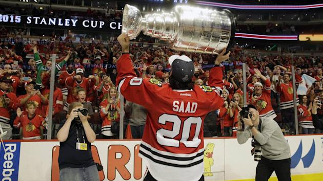 Chicago forward Brandon Saad hoists the Stanley Cup after a final that produced disappointing ratings for Rogers.