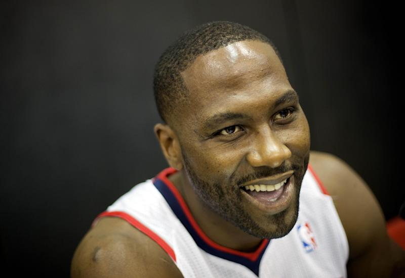 Atlanta Hawks' Elton Brand answers a reporter's question during the team's NBA basketball media day, Monday, Sept. 30, 2013, in Atlanta. (AP Photo/David Goldman)