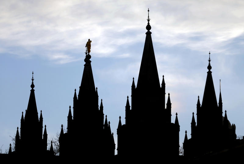 FILE- In this Jan. 3, 2018, file photo, the angel Moroni statue, silhouetted against the sky, sits atop the Salt Lake Temple of The Church of Jesus Christ of Latter-day Saints, at Temple Square, in Salt Lake City. The Church of Jesus Christ of Latter-day Saints has postponed a key meeting of top global leaders scheduled for April 1-2 because of the spread of the coronavirus around the world. The faith is also discouraging members from traveling from outside the United States for a twice-yearly conference set for the weekend of April 4-5 in Salt Lake City, the religion said in a news release Thursday, Feb. 27, 2020. (AP Photo/Rick Bowmer, File)