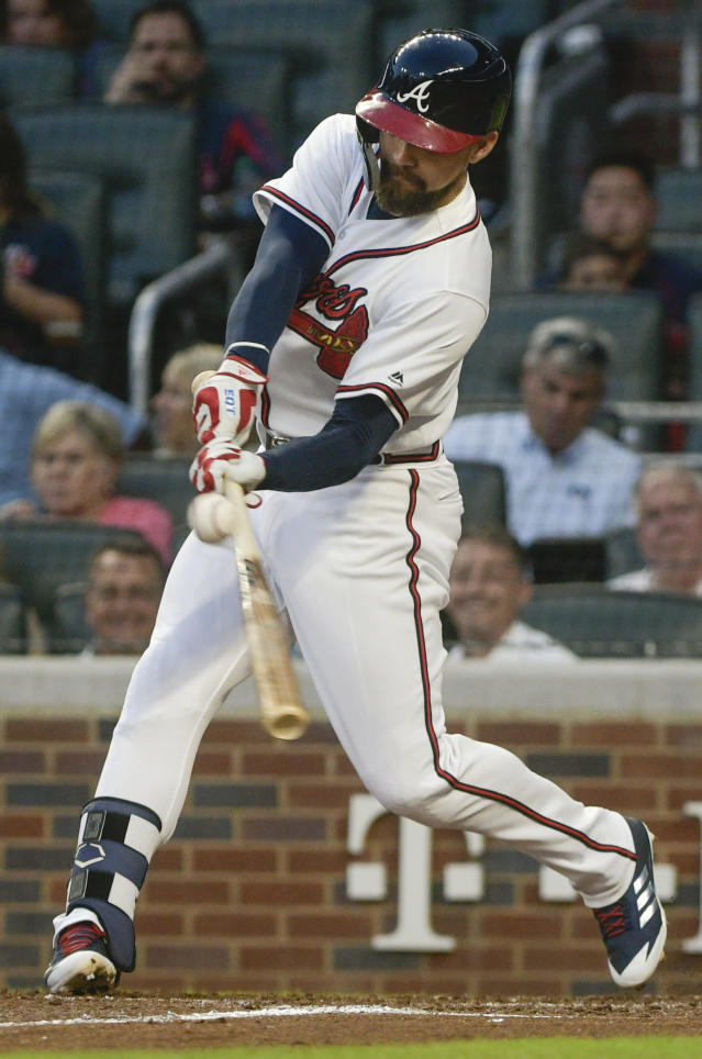 Atlanta Braves' Ender Inciarte hits a fly ball for an RBI single against the New York Mets during the fourth inning of a baseball game Tuesday, June 12, 2018, in Atlanta. (AP Photo/John Amis)