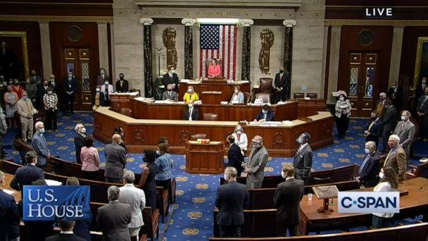 PHOTO: Members stand as the House of Representatives pays tribute to Rep. John Lewis on the floor of the U.S. House of Representatives in Washington, July 20, 2020. (C-SPAN)