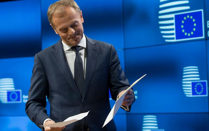 European Council president Donald Tusk holds the letter giving Britain's official notice under Article 50  - Credit: EPA/OLIVIER HOSLET