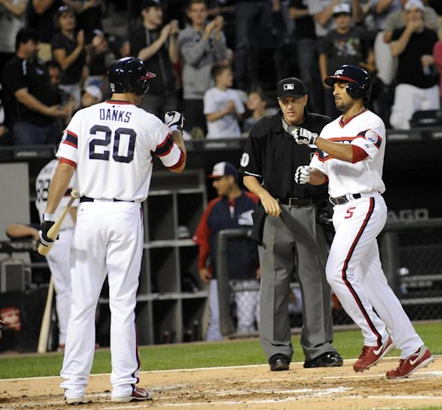 Chicago White Sox's Marcus Semien, right, celebrates with Jordan Danks after Semien's home run during the second inning of a baseball game against the Kansas City Royals on Saturday, Sept. 28, 2013, in Chicago. (AP Photo/Joe Raymond)