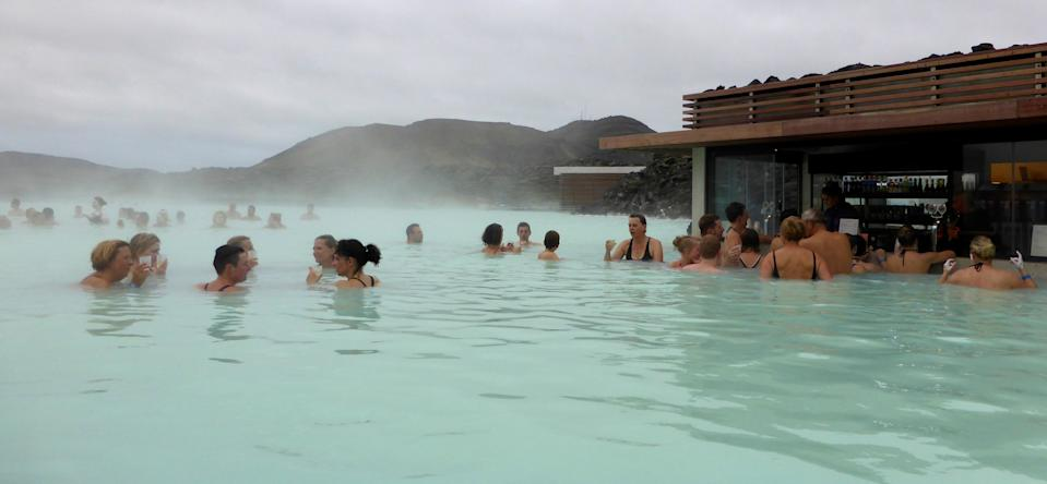 Visitors enjoy a drink in the Blue Lagoon geothermal spa in Grindavik, Iceland, May 25, 2016. REUTERS/Gwladys Fouche