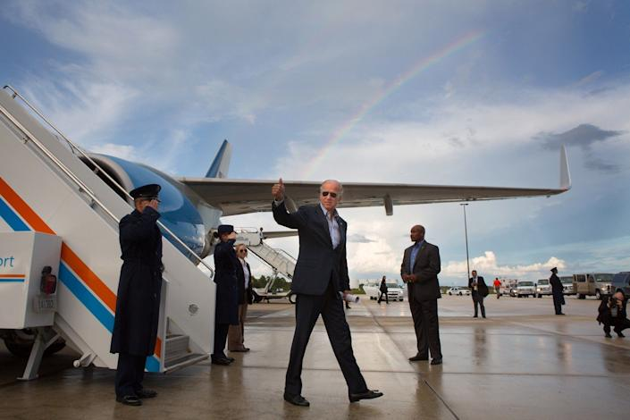 When we landed at Southwest Florida International Airport aboard Air Force Two, it was still raining, but by the time we taxied to our parking spot the rain had let up and a rainbow was starting to form in the sky. I tried to get into position to capture the rainbow and the Vice President de-planing, and Air Force Two. As he walked to the cars, he gave me a thumbs-up — and that was the photo. September 28,2012.