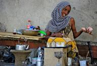 An Ethiopian refugee who fled the fighting in Tigray sells tea in Village 8 in Gedaref State, eastern Sudan