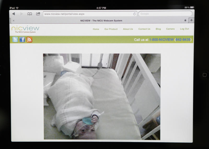 This Aug. 13, 2012, photo shows a webcam feed of four-month-old Emily St. Martin in the Neonatal Intensive Care Unit at Ochsner Medical Center, viewed from her family's home in LaPlace, La. Her parents watch her from a webcam installed over her crib. (AP Photo/Gerald Herbert)